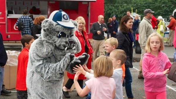 Jack the Bulldog Mascot talking to community children