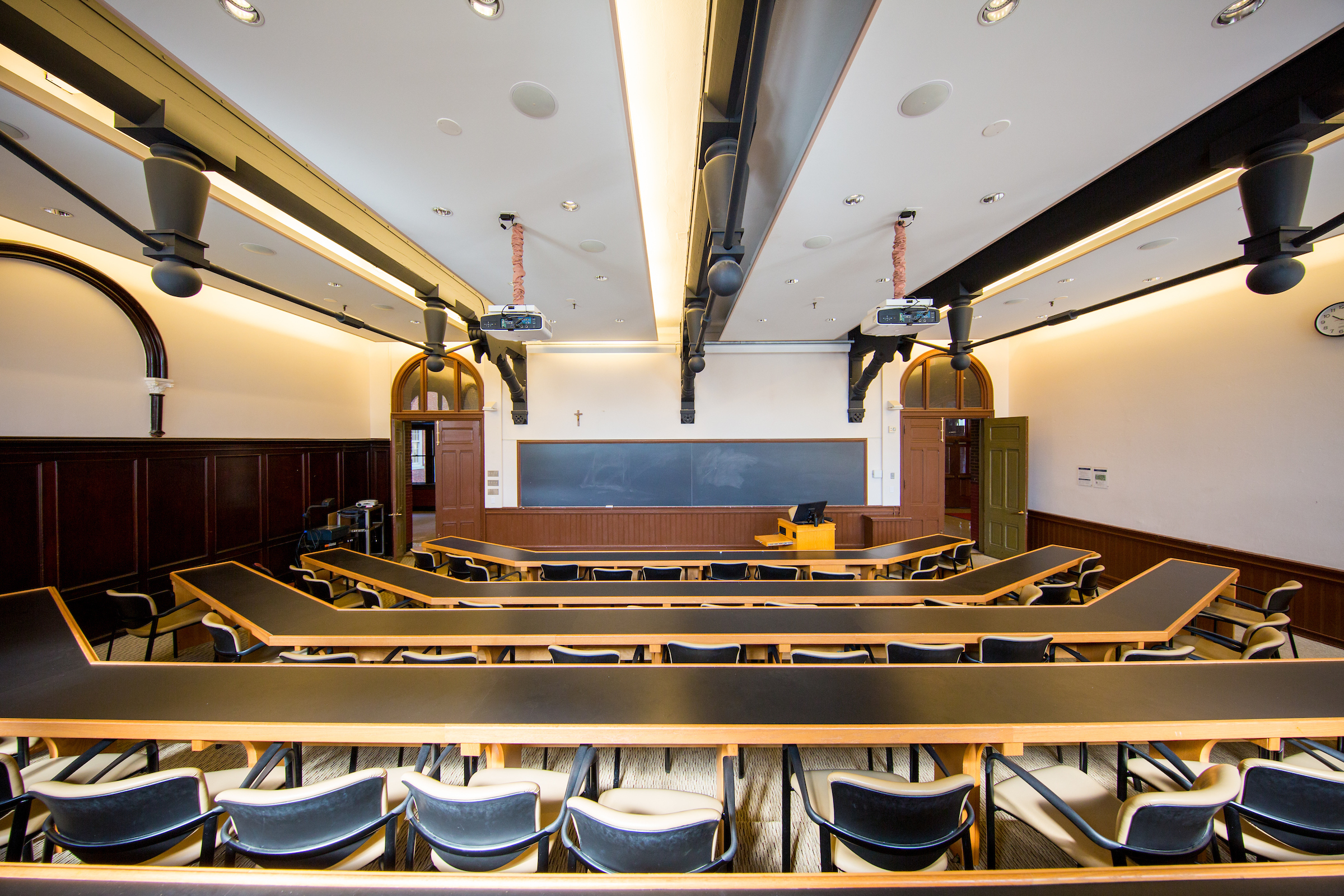 Empty Healy Hall classroom, blackboard in the front of lecture hall